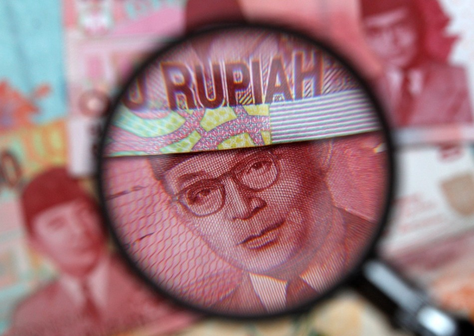 indonesias-rupiah-drops-below-12000-dollar-first-time-since-2009